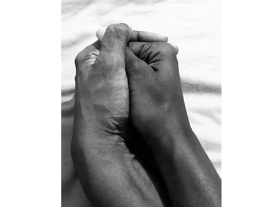 Patrice and her mother's hands held together